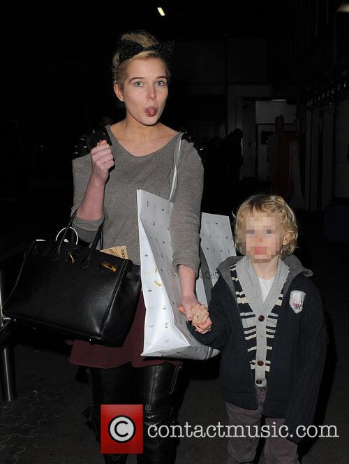 Helen Flanagan arrives at a train station