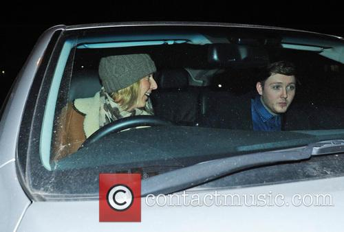 James Arthur and a female friend leave the...