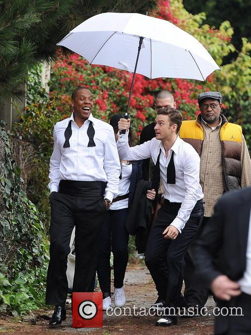 JT and Jay-Z joke together at the Suit & Tie video shoot