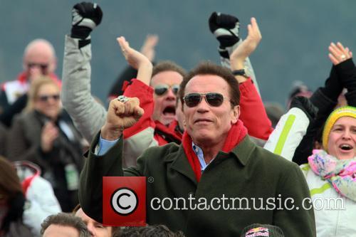 Arnold Schwarzenegger leaving the VIP spectators grand stand