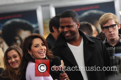 Sarah Shahi and Aj Calloway