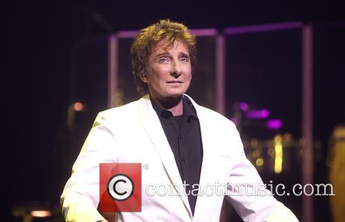 Barry Manilow performs during the opening night of...
