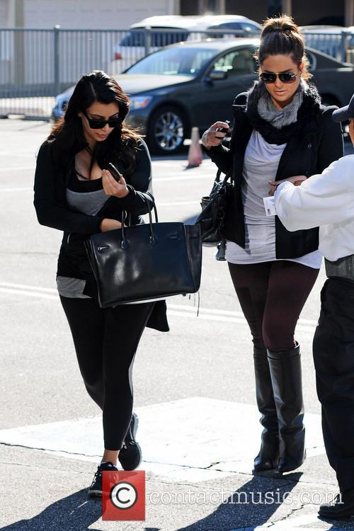 Kim Kardashian hands her car keys to the valet