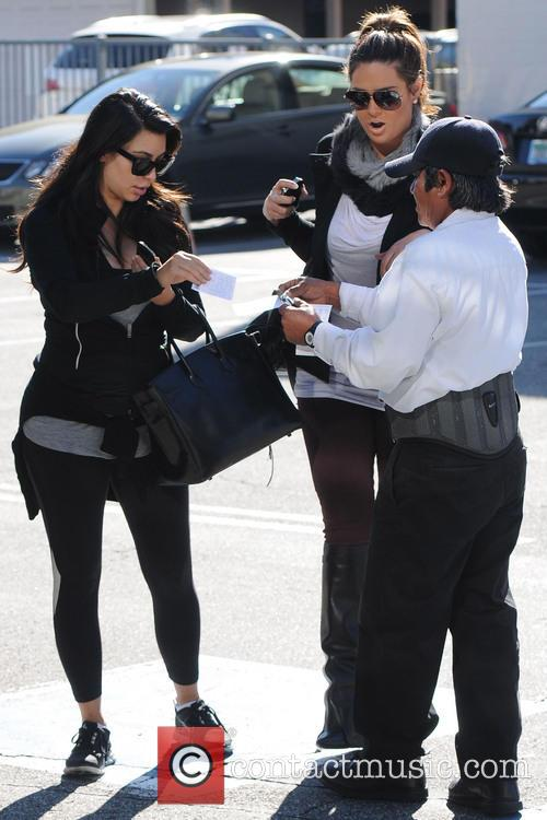 Kim Kardashian hands her car keys to the...