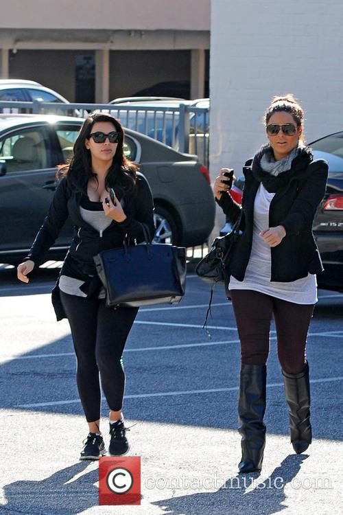 Kim Kardashian hands her car keys to the valet