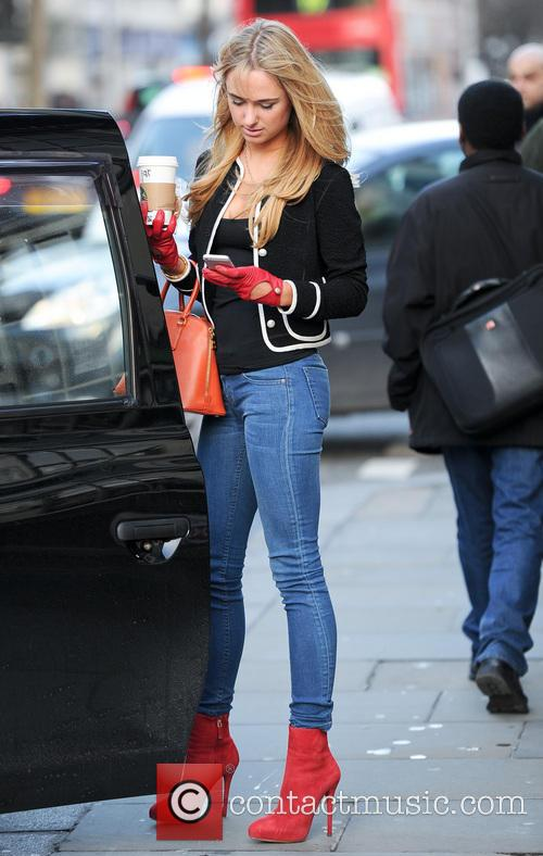 Kimberley Garner stops for Starbucks while walking her...