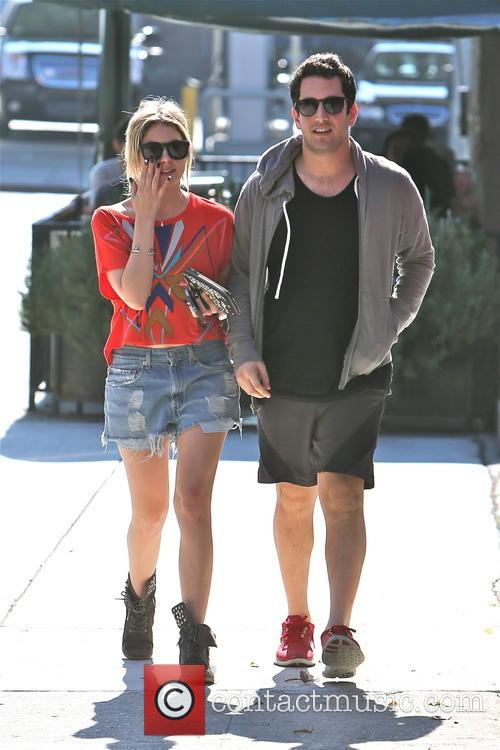 Ashley Benson and a male friend are seen...