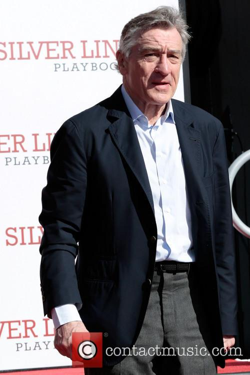 Robert De Niro places his hand and foot prints in cement