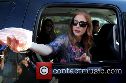 Jessica Chastain sign autographs for fans