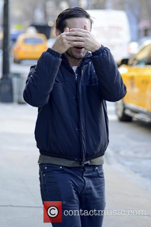 Tobey Maguire shields himself with his hands during a stroll in Manhattan