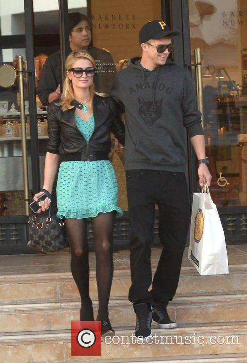 Paris Hilton and her boyfriend River Viiperi leaving...