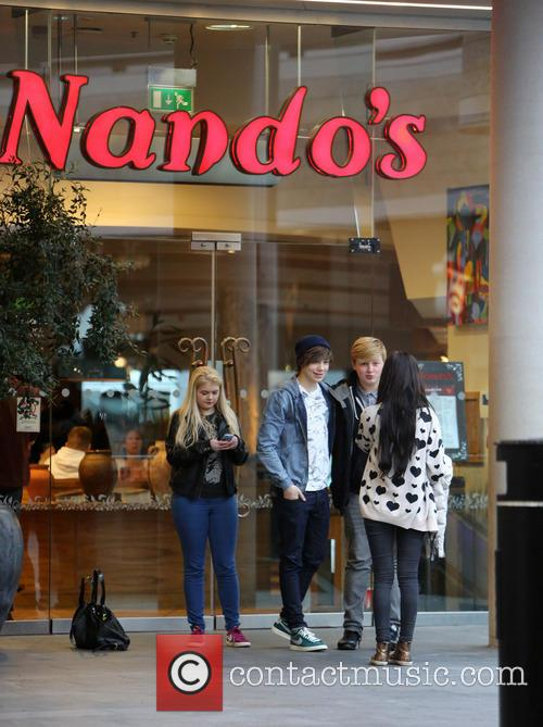 George Shelley poses for pictures with fans