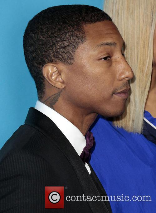 Pharrell Williams and Guest 5
