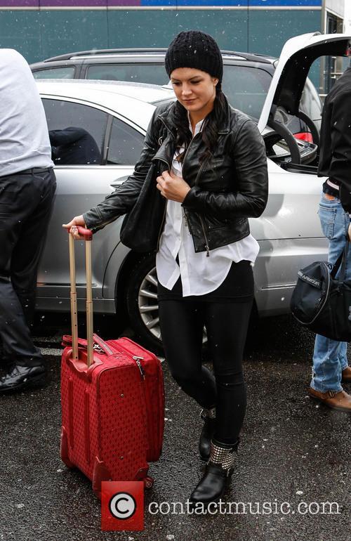 Henry Cavill and Gina Carano at Heathrow