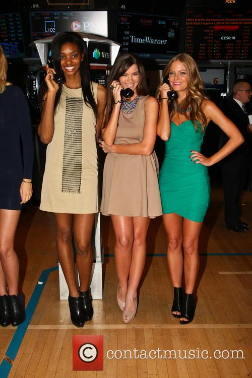 Sports Illustrated swimsuit models ring the NYSE closing...