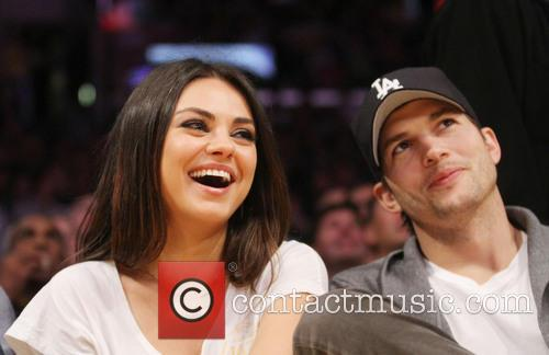 Mila Kunis and Ashton Kutcher watch the LA Lakers vs.Phoenix Suns at the Staples Center