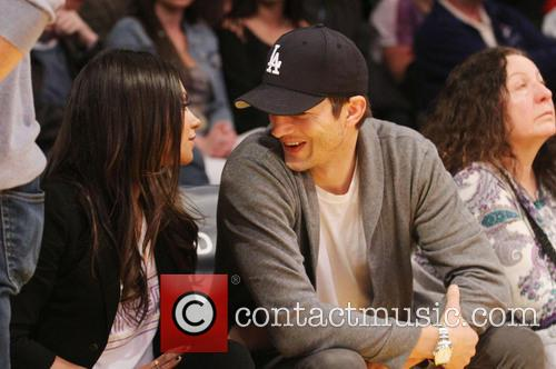 Ashton and Mila watch the Lakers