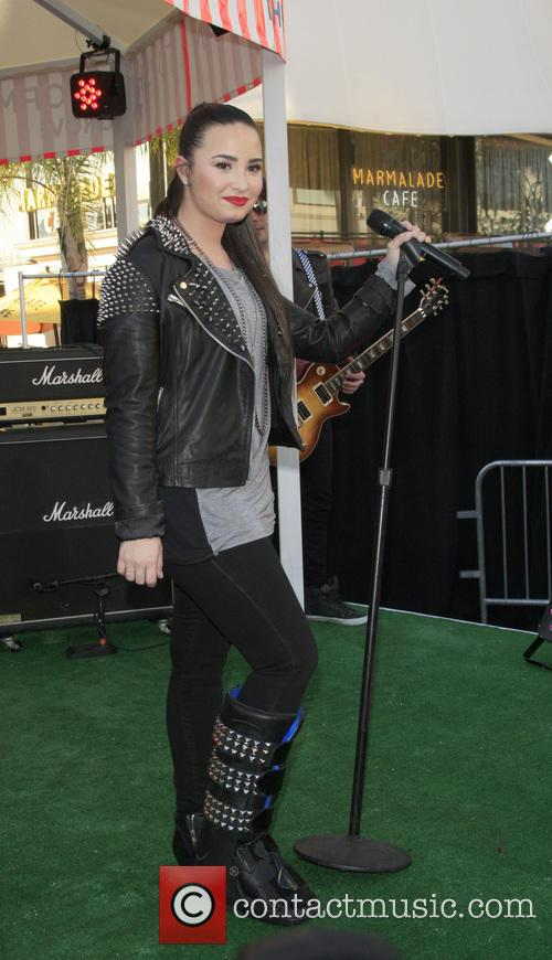 Demi Lovato performs the Topshop LA launch