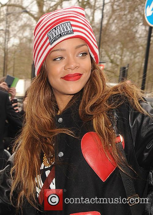 Rihanna arrives at her hotel ahead of her...