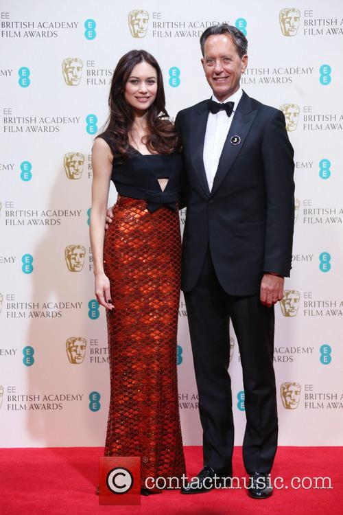 Olga Kurylenko and Richard E. Grant 2