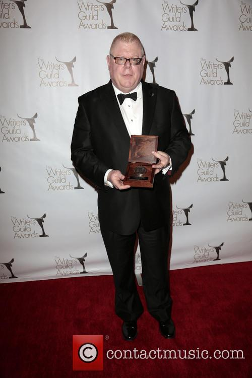 Former President of Writers Guild West Daniel Petrie, Jr., poses with the Morgan Cox Award, Writers Guild Awards