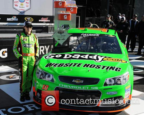 Danica Patrick poses after becoming the first women...