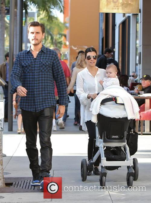 Kourtney Kardashian, Scott Disick and their daugher, Penelope...