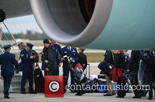 president barack obama's staff carrying golf bags 3512477