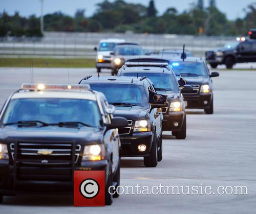 Barack Obama and Presidential Motorcade Arrives At Palm Beach International Airport 9