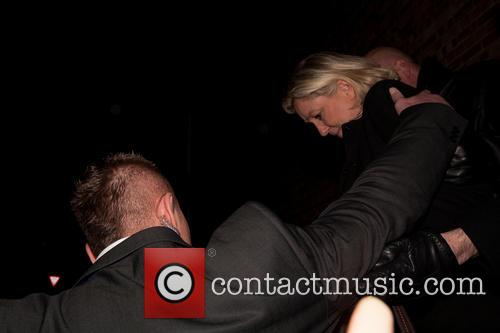 Marine Le Pen being escorted