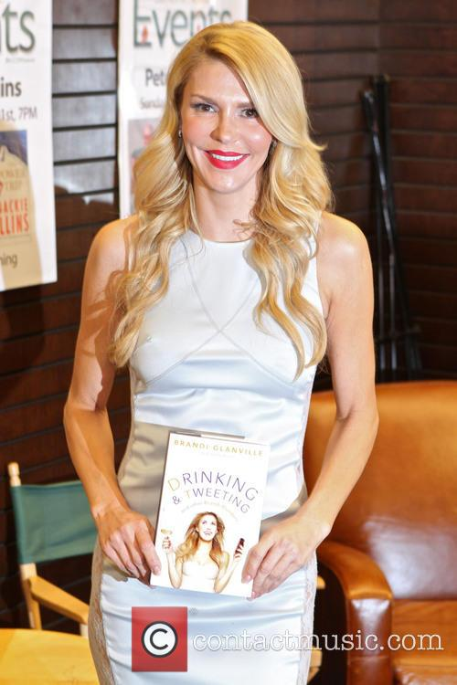 Brandi Glanville signs copies of her book