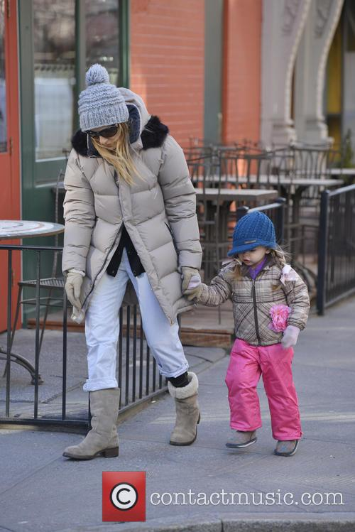 Sarah Jessica Parker and her twin daughters, Marion...