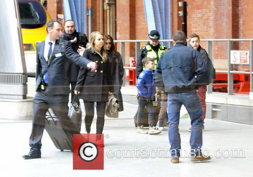 Victoria Beckham and her kids arrive at St...