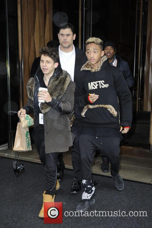 The Smith family depart their downtown hotel in...