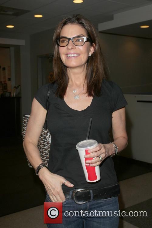 Sela Ward arriving at LAX