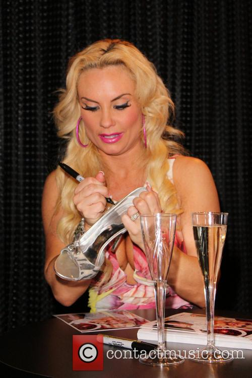 Coco Austin is seen meeting and greeting fans...