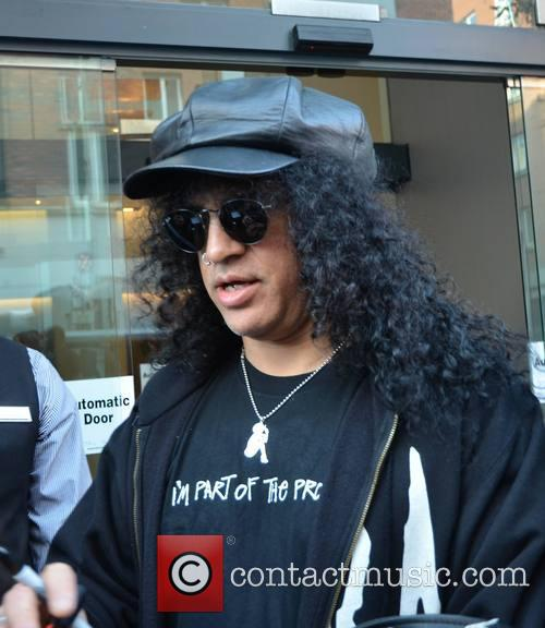 slash slash seen outside his hotel 3537302