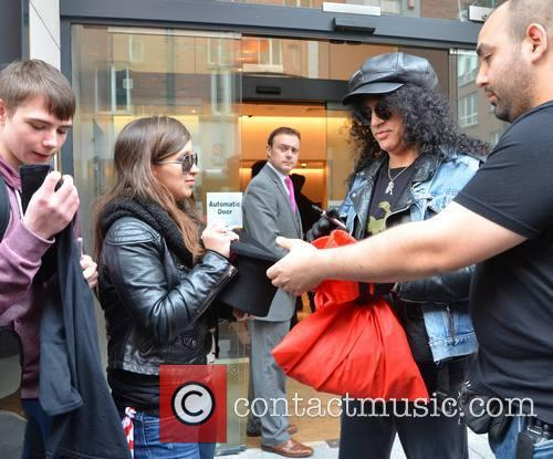 Slash meets with his fans outside The Morrison...