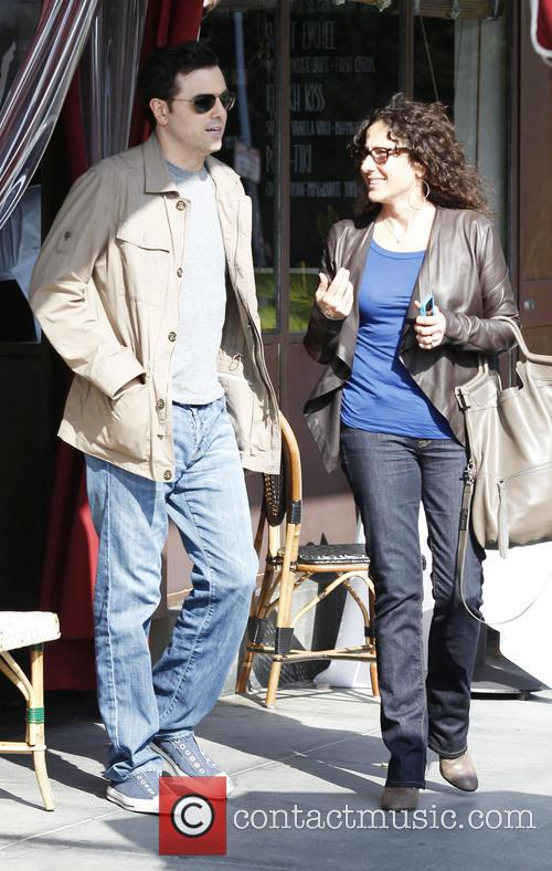 Actor Seth MacFarlane and a friend leave a cafe