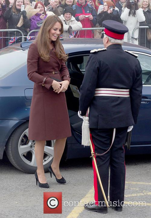 catherine duchess of cambridge royal princess pregnant burgundy coat visit clutch bag military officer kate middleton 3541962