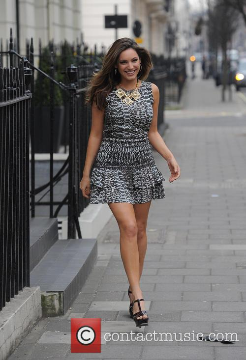 Kelly Brook leaving her house.