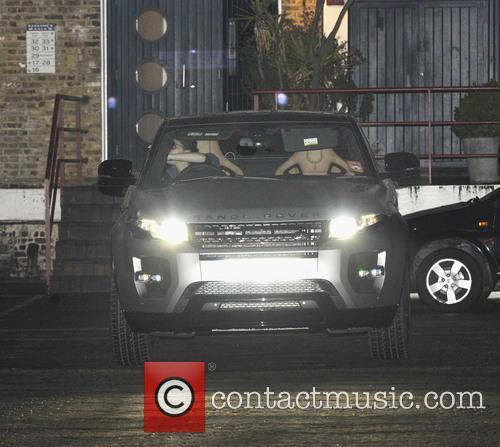 Victoria Beckham seen driving her new Range Rover...