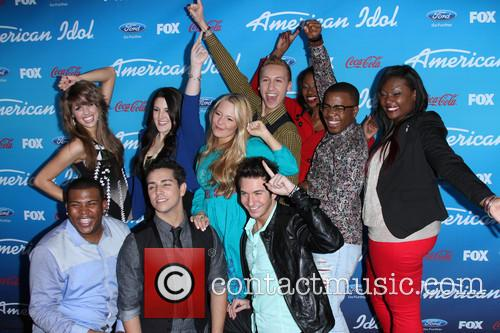Devin, (top L-r) Finalists Angie Miller, Kree Harrison, Janelle Arthur, Amber Holcomb, Burnell Taylor, Candice Glover (bottom L-r) Curtis Finch Jr., Lazaro Arbos, Paul Jolley and American Idol 4