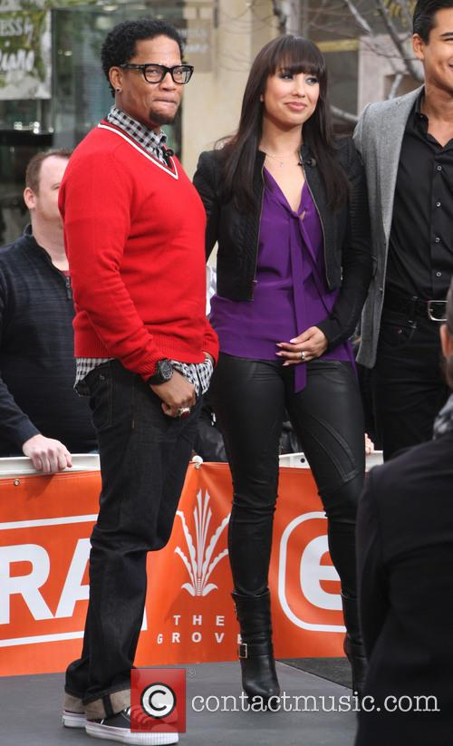 Cheryl Burke and D. L. Hughley 11