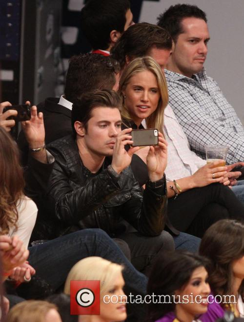 Celebrities watch the Los Angeles Lakers play the...