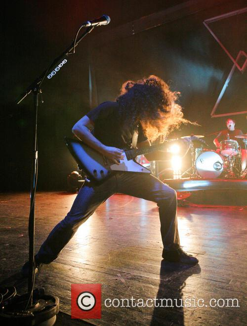 Coheed and Cambria performing live