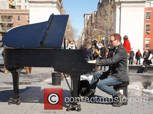 Musician and pianist Colin Huggins plays the piano...