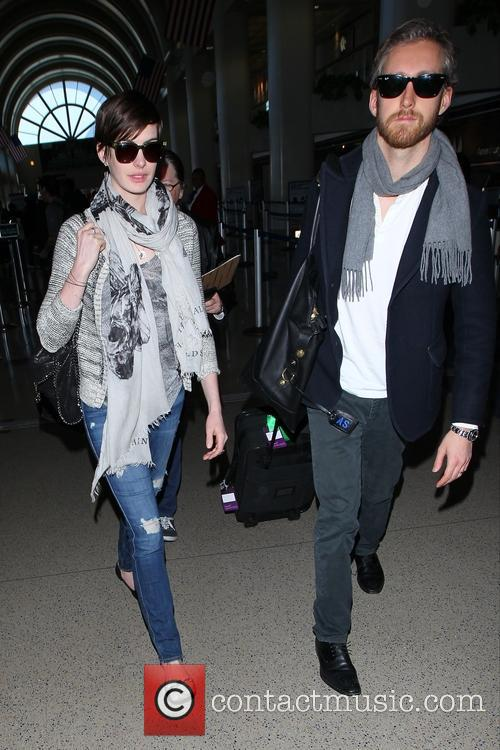 Anne Hathaway and husband Adam Shulman arrive at LAX Airport