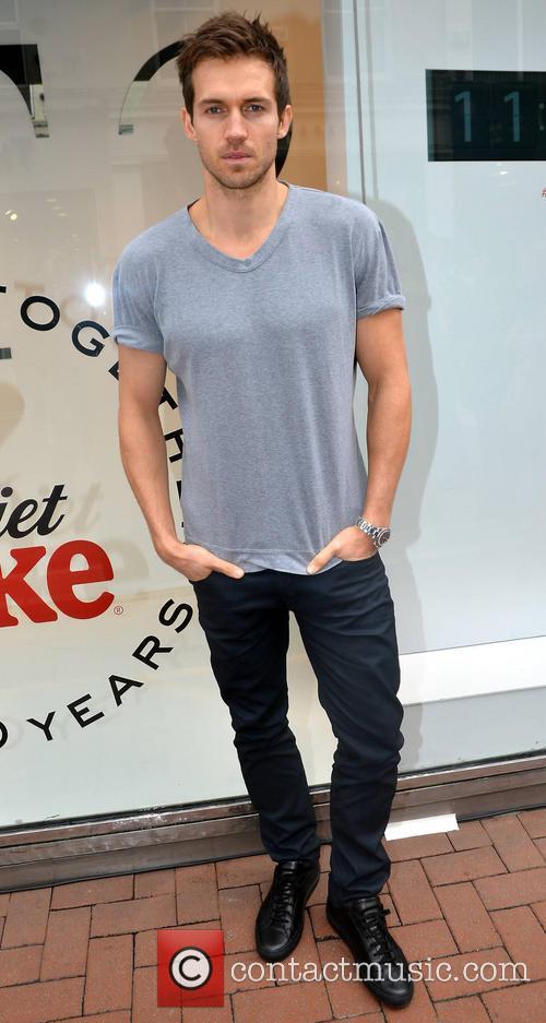 New Diet Coke hunk Andrew Cooper celebrates the...