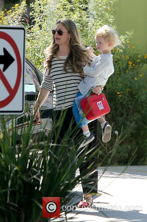 Rebecca Gayheart collects her daughter from school